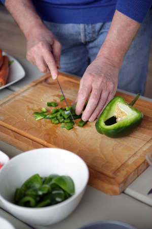 unmarried: Chopping pepper Stock Photo