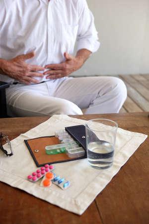 pang: Stomach pain Stock Photo