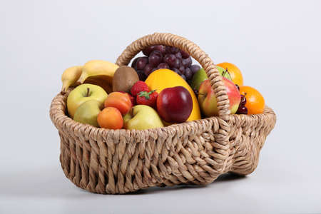 unblemished: Wicker basket full of fresh fruit at a slight angle