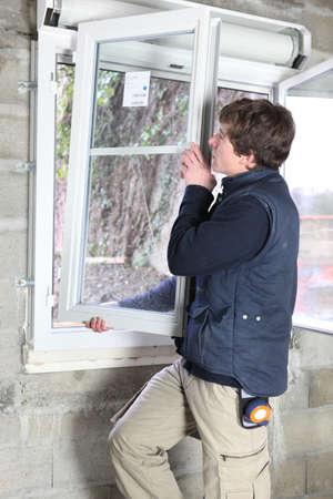Man placing a window photo