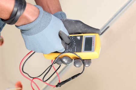 Electrician using voltmeter Stock Photo - 22399922