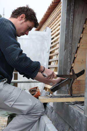 roofing: Roofer working with slate