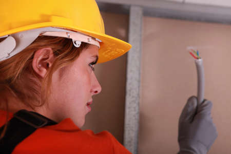 Female electrician Stock Photo - 22400004
