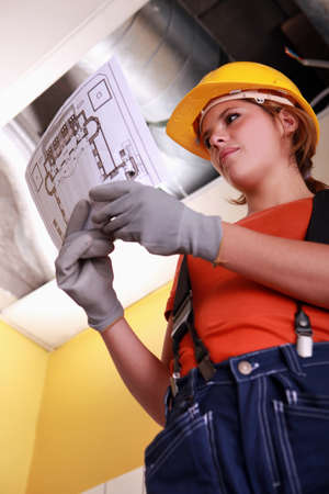 Heating engineer looking at a diagram Stock Photo - 22400012