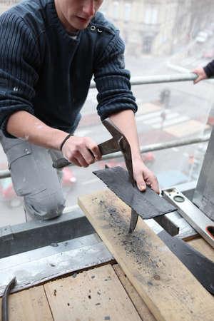 roofer: Roofer preparing slate