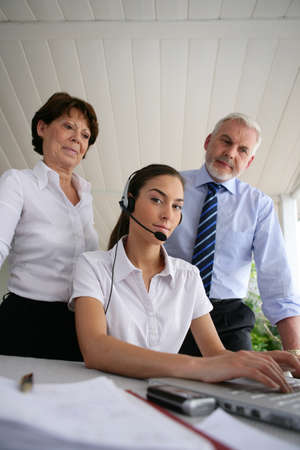 Business people at a laptop with headset photo