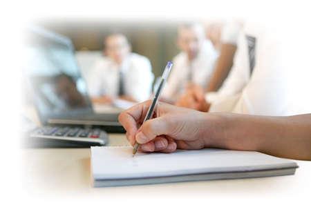 Escribir notas en una reunión Foto de archivo