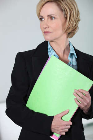armful: Businesswoman with an armful of folders Stock Photo