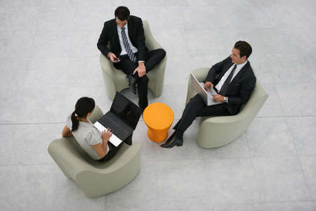 atrium: Businesspeople sitting in an atrium