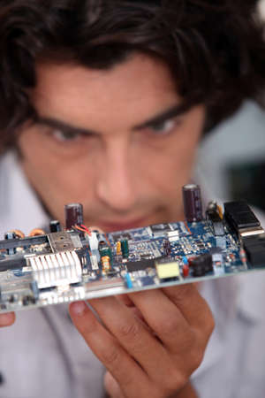 edv: Man looking at  an electronic board Stock Photo