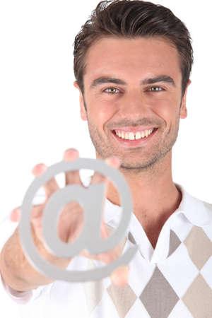 Man holding at symbol photo