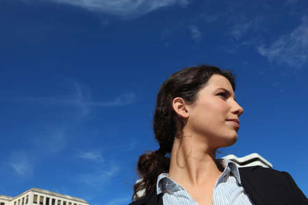 Young businesswoman against a blue sky photo