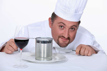corrugate: Chef with wine glass and tin of food Stock Photo