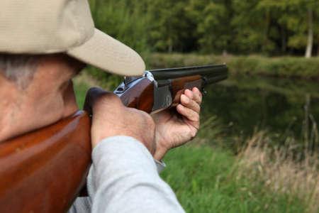 rifle: Hunter with shotgun