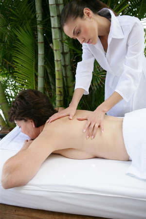 Woman receiving a back massage Stock Photo - 22393879