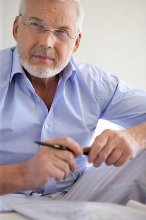 mid fifties: Pensive gray-haired man