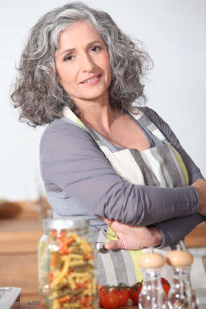 Portrait of mature woman wearing apron Stock Photo - 22393947