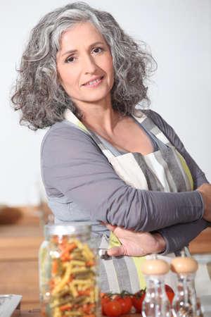 Portrait of mature woman wearing apron photo