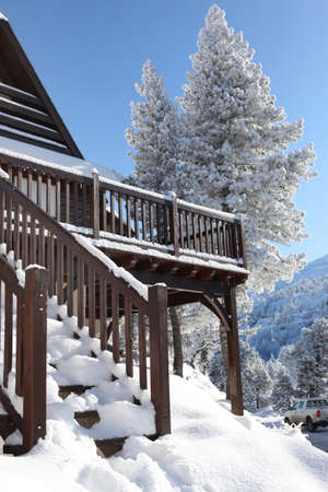 coziness: Snow covered chalet Stock Photo