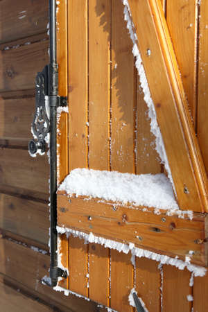 Snow covered shutters photo