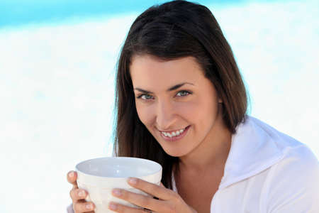 Brunette woman with bowl photo