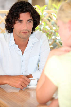 Man and woman drinking coffee outside Stock Photo - 22395543