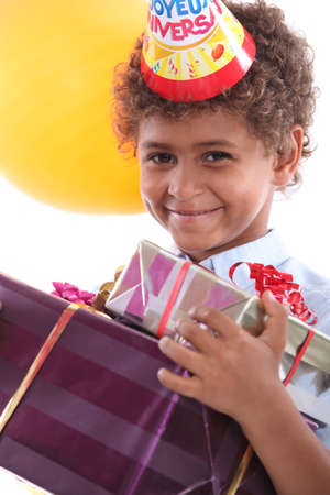 Smiling boy with gifts photo