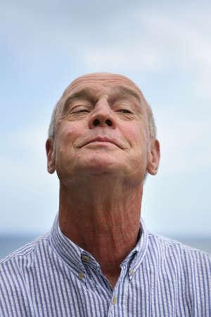 55 60 years: Senior man straining