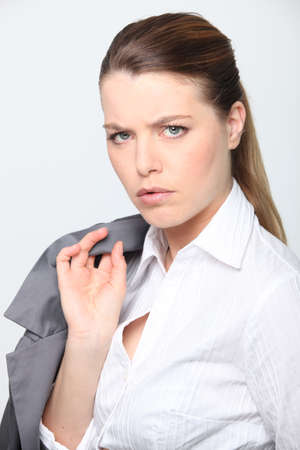 blonde businesswoman looking concerned photo