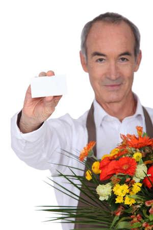 median age: Florist showing business card
