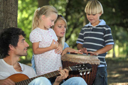portrait of a family playing music photo