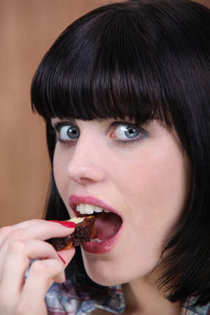 guilty pleasures: Woman eating a slice of cake