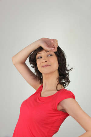 brunette wearing red top striking a pose photo
