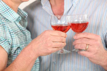 50 55 years: Couple drinking rose wine