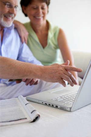 Senior couple using a laptop photo