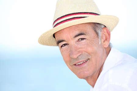 wistful: Man wearing hat by coast
