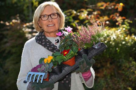 senior with plants photo