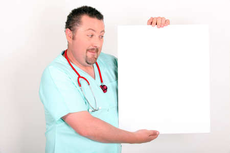 scepticism: Doctor holding a blank sign
