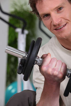 Man lifting a dumbbell photo