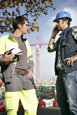 hard working people: Construction workers handling a problem Stock Photo