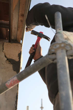 hinge joint: Close-up of a man on scaffolding