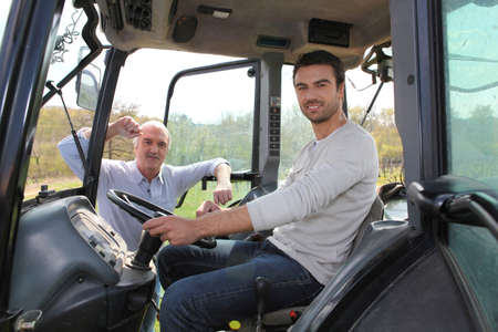 Man driving tractor photo