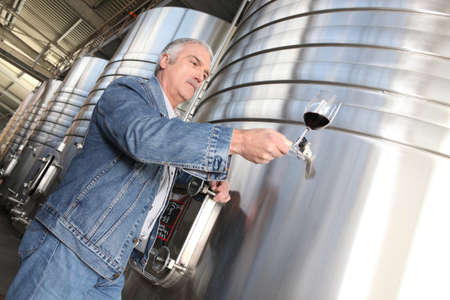 Winegrower with glass of wine photo