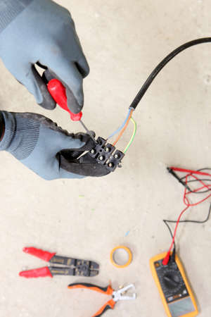 junctions: Electrician wiring a house Stock Photo