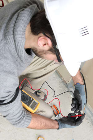 Electrician with multimeter photo
