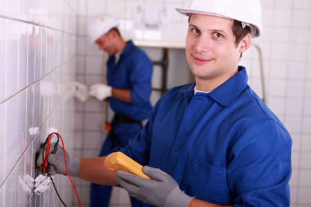 voltmeter: Young electrician using a voltmeter Stock Photo