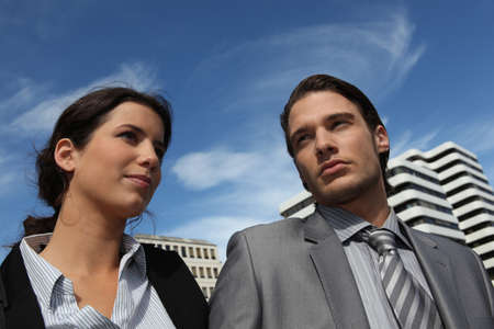 apathetic: Colleagues standing outside together Stock Photo