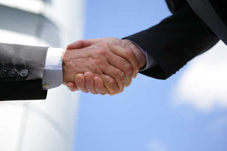ovation: Two businesspeople shaking hands outdoors Stock Photo