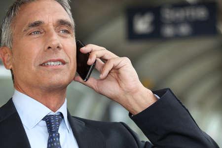 businessman waiting call: Businessman on the phone Stock Photo