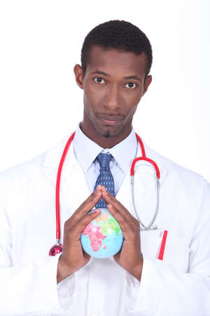 Doctor holding globe Stock Photo - 22506634
